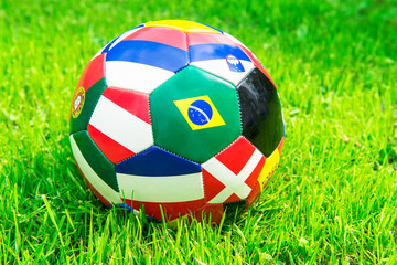 Ball with flags on green grass