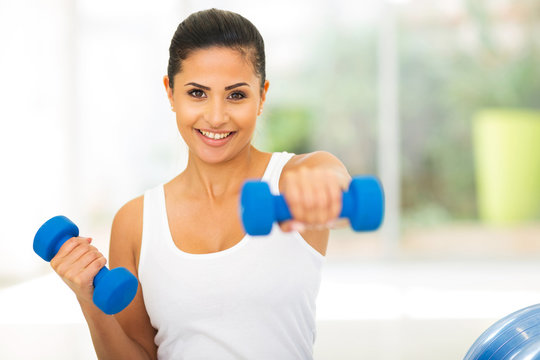 pretty woman working out dumbbells