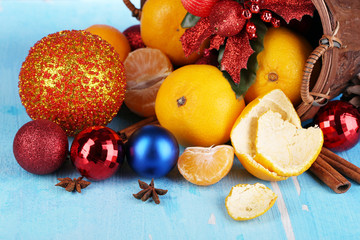 Christmas tangerines and Christmas toys in basket
