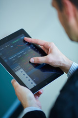 men holding digital tablet