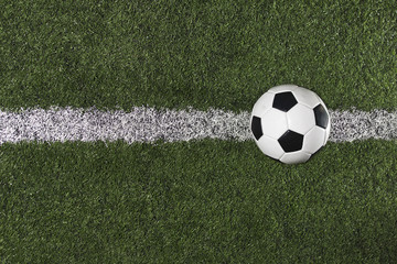 Soccer Ball on the midfield on a Soccer Field