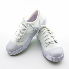 White sport shoes on white background.