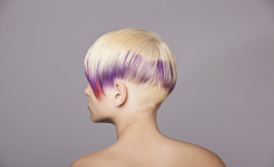 Blond hair girl with violet paint. Beautiful Woman
