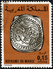 stamp printed in Morocco shows Rabat silver coin