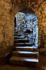 Fototapete - Arch in underground castle