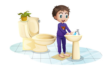 A boy washing his hands at the sink