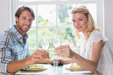 Cute smiling couple having a meal together