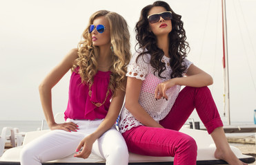 fashion photo of two sexy glamour models in sunglasses