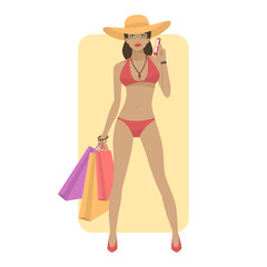 Woman in swimsuit holds phone and bags