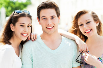Young man with two female friends
