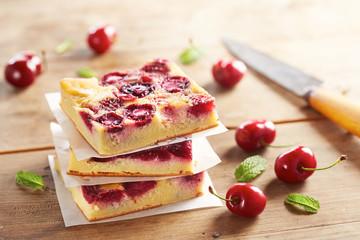 Cherry clafoutis pie on wooden table