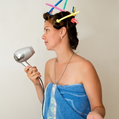 Woman with curlers on her head