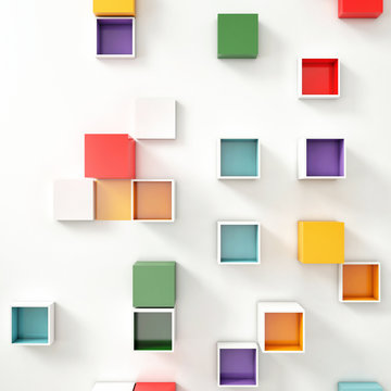 Color Cubes in a random of pattern on White Wall.