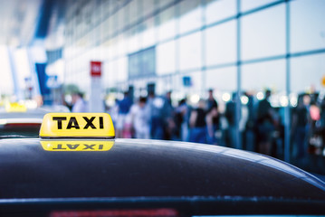 Taxi car waiting arrival passengers in front of Airport Gate Fototapete