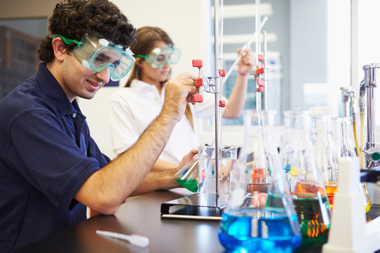 Pupils Carrying Out Experiment In Science Class