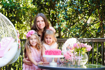 mother and her daughters celebrate family event outdoor in the g