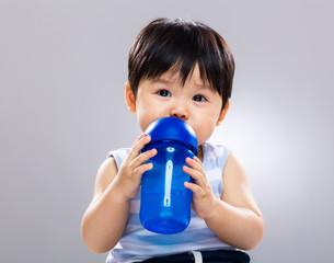 Little boy drink with water bottle