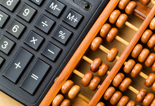 Ancient abacus and modern calculator