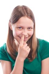 Teen girl picking her nose