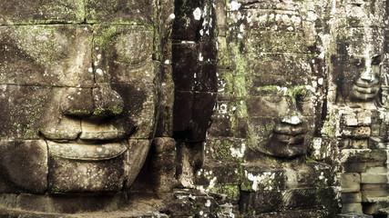 Giant Stone Faces at Bayon Temple at Angkor, Cambodia
