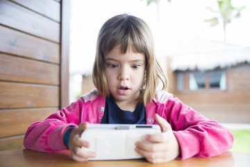 little girl with a smartphone