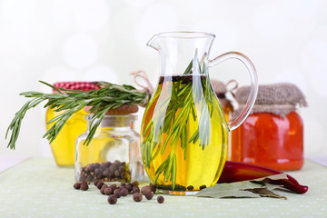 Essential Oil with rosemary in glass jug and jars with tasty