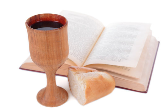 Cup of wine,bread and book isolated on white
