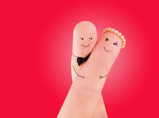 happy couple - painted at fingers against red background