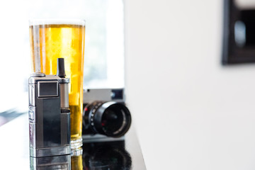 Portable vaporizer, digital camera and beer