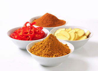 Canvas Prints Spices Curry powder, ground cinnamon, sliced ginger root and red pepper