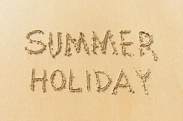 Word summer holiday on beach