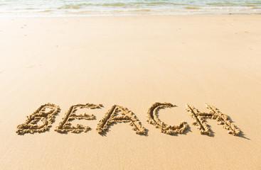 Word beach written on beach