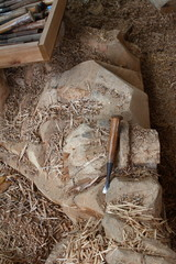 Lay the  carving tools together on the wooden