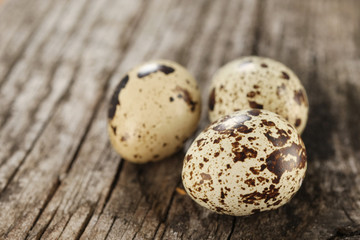 quail eggs on the background of old  wooden planks
