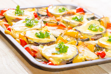 Baked mushrooms with cheese and parsley with vegetables