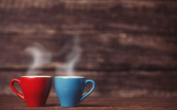 Two tea or coffee cup on wooden table.