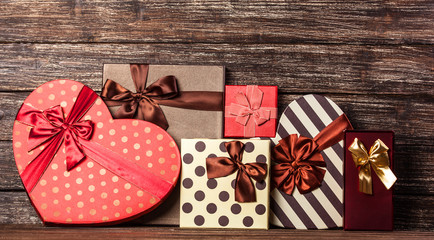 Group of gifts on wooden table.