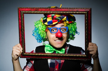 Wall Mural - Funny clown with picture frame