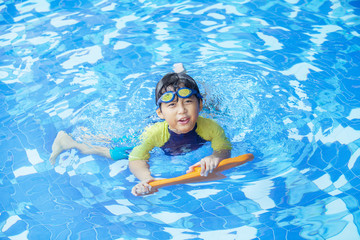 Cute boy playful on the pool 1