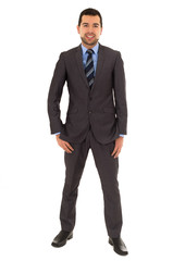 hispanic man standing in a suit