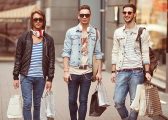 Three Young male fashion metraseksuals shop shopping walk