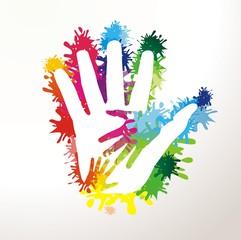 Hände auf Farbklecksen