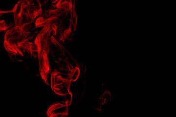 Red smoke on black background