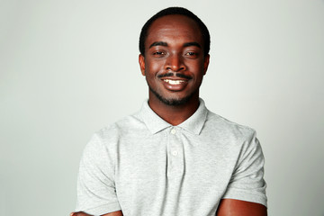 Portrait of a smiling african man on grya background