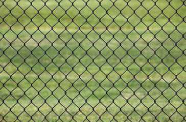 Metal fence, Detail of metal fence in a Green grass background
