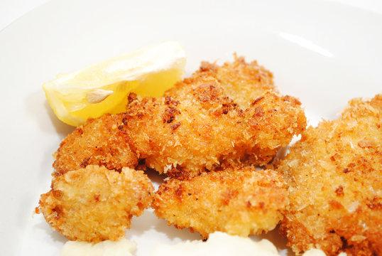Crispy Fried Catfish Served with a Lemon Wedge
