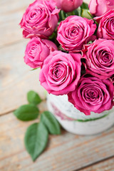 Bouquet of beautiful pink roses on wooden background.