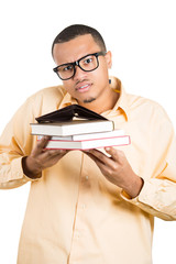 Poor student with glasses holding empty wallet and books