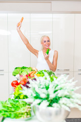 Happy woman cooks in the kitchen