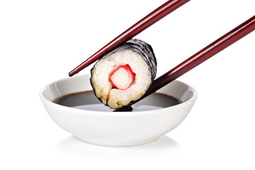 Hosomaki sushi with chop sticks and soy sauce
